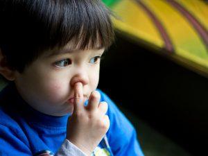 Boy picking nose