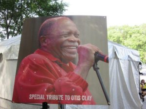 Poster of Otis Clay next to stagesm